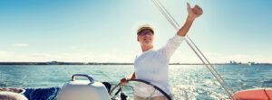6-MY-ACCOUNT-Man-sailing-thumbsup-300x111 sailing, age, tourism, travel and people concept - happy senior