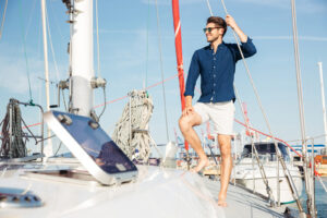 man-standing-yacht-300x200 Young stylish sailor man standing on the yacht